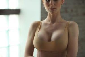 Model's Breasts in Tight Low Cut Sports Bra