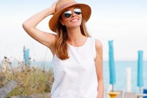 Middle Aged Female Wearing Sunhat and Aviator Glasses
